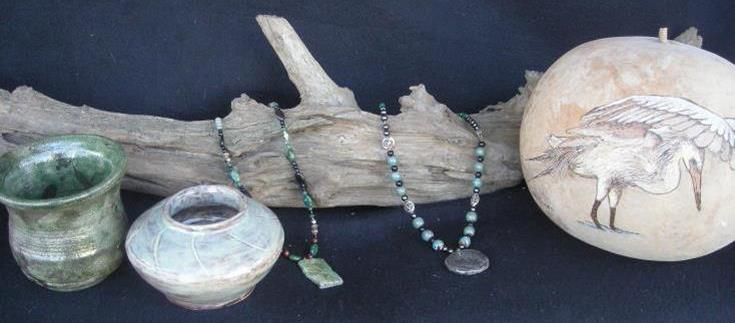 driftwood and handcrafted displayed pottery